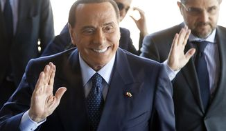 FILE - In this Wednesday, May 16, 2018 file photo, former Italian Prime Minister Silvio Berlusconi arrives for a meeting of the EPP at a hotel in Sofia, Bulgaria. ilvio Berlusconi is reportedly getting back into football. The Gazzetta dello Sport says that Berlusconi's family holding company Fininvest has reached a deal to purchase Serie C club Monza in a deal worth between 2.5 and 3 million euros ($3-3.5 million). The 81-year-old Berlusconi, a three-time Italian premier, last year sold AC Milan to a Chinese-led consortium for $800 million. U.S.-based hedge fund Elliott Management then took over control of Milan two months ago after the Chinese owner missed a deadline to repay part of a loan. (AP Photo/Darko Vojinovic, File)