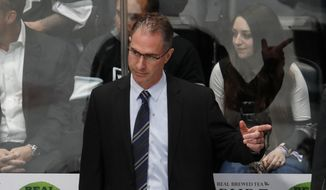 FILE - In this March 22, 2018, filer photo, Los Angeles Kings coach John Stevens gestures to his team during the third period against the Colorado Avalanche in an NHL hockey game in Denver. Stevens returns for his second full season behind the Kings' bench after his debut club was swept in the opening round of the postseason. (AP Photo/David Zalubowski, File) **FILE**