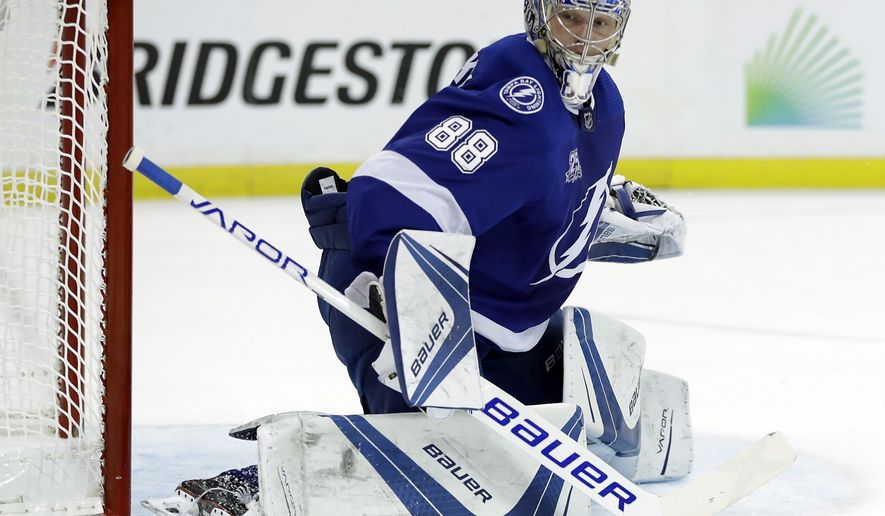 In this May 23, 2018, file photo, Tampa Bay Lightning goaltender Andrei Vasilevskiy watches the puck go past during the first period of Game 7 of the NHL Eastern Conference finals hockey playoff series against the Washington Capitals, in Tampa, Fla. (AP Photo/Chris O'Meara, File)