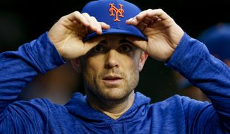 New York Mets' David Wright walks through the dugout during a baseball game against the Washington Nationals at Nationals Park, Sunday, Sept. 23, 2018, in Washington. Wright has not played for the Mets since May 2016 because of neck, back and shoulder injuries. (AP Photo/Andrew Harnik)