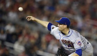 New York Mets starting pitcher Jacob deGrom delivers a pitch during the seventh inning of the team's baseball game against the Washington Nationals, Friday, Sept. 21, 2018, in Washington. The Mets won 4-2. (AP Photo/Nick Wass) ** FILE **