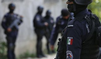 FILE - In this June 21, 2018 file photo, security forces patrol in Acapulco, Mexico. The entire local police force in the once-glittering resort of Acapulco, have been disarmed and placed under investigation announced Mexican authorities on Tuesday, Sept. 25, 2018, claiming the local cops were infiltrated by drug gangs. Law enforcement duties in the seaside city were taken over by soldiers, marines and state police. (AP Photo/Marco Ugarte, File)