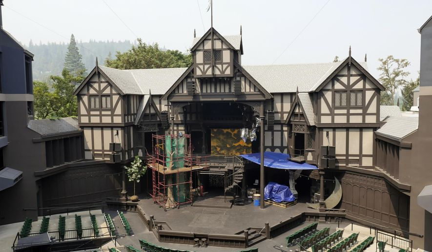 This Aug. 10, 2018 photo provided by the Oregon Shakespeare Festival shows the outdoor theatre with wildfire smoke on the horizon in Ashland, Ore. The famed Shakespeare festival, that attracts tourists from around the world, says it lost $2 million this summer because smoke from wildfires forced it to cancel more than two dozen outdoor performances. (Kim Budd/Oregon Shakespeare Festival via AP)