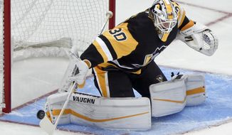 FILE- In this Sept. 22, 2018, file photoPittsburgh Penguins goaltender Matt Murray sweeps the puck aside as he plays against the Columbus Blue Jackets during an NHL preseason hockey game in Pittsburgh. (AP Photo/Keith Srakocic, File)
