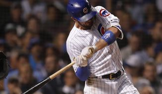 Chicago Cubs' Kris Bryant is hit by a pitch thrown by Pittsburgh Pirates' Chris Archer during the fourth inning of a baseball game Tuesday, Sept. 25, 2018, in Chicago. (AP Photo/Jim Young)