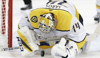 Nashville Predators goaltender Juuse Saros (74) dives on the puck after making a save on a shot by the Tampa Bay Lightning during the second period of an NHL preseason hockey game Saturday, Sept. 22, 2018, in Tampa, Fla. (AP Photo/Chris O'Meara)