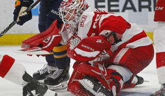 FILE - In this Thursday, March 29, 2018, file photo, Detroit Red Wings goalie Jimmy Howard (35) makes a save during the third period of an NHL hockey game against the Buffalo Sabres, in Buffalo, N.Y. For the new season, Detroit appears to have a solid tandem in goal: Jimmy Howard and Jonathan Bernier. (AP Photo/Jeffrey T. Barnes, File)