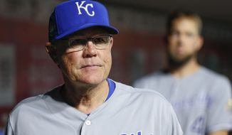 Kansas City Royals manager Ned Yost stands in the dugout during the fourth inning of the team's baseball game against the Cincinnati Reds, Tuesday, Sept. 25, 2018, in Cincinnati. (AP Photo/John Minchillo)