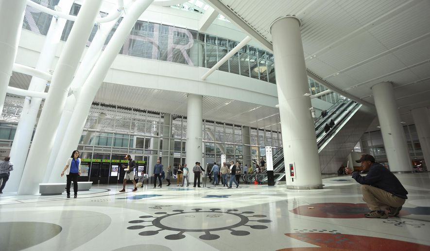FILE - In this file photo taken Aug. 15, 2018, tourists take photos inside the new San Francisco Transbay Transit Center in San Francisco. San Francisco officials shut down the city's $2.2 billion transit terminal Tuesday, Sept. 25, 2018, after a crack was found in a steel beam. (AP Photo/Lorin Eleni Gill, File)