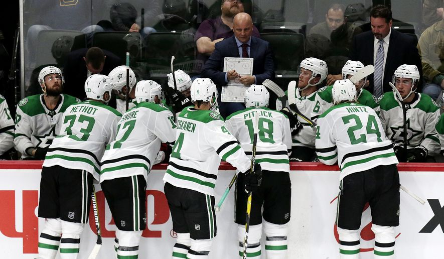 FILE - In this Sept. 20, 2018, file photo, Dallas Stars coach Jim Montgomery talks to players during a time out against the Minnesota Wild in the third period during a preseason NHL hockey game, in St. Paul, Minn. Montgomery makes the jump from the college ranks (University of Denver), where he had an offensive team. (AP Photo/Andy Clayton-King, File)