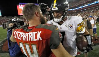 Pittsburgh Steelers quarterback Ben Roethlisberger, right, shakes hands with Tampa Bay Buccaneers quarterback Ryan Fitzpatrick (14) after the Steelers defeated the Buccaneers 30-27 during an NFL football game Monday, Sept. 24, 2018, in Tampa, Fla. (AP Photo/Mark LoMoglio)