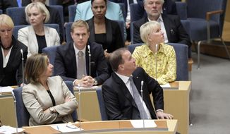Swedish Prime Minister Stefan Lofven, right, attends parliament during a vote of confidence in the Swedish Parliament Riksdagen, Tuesday Sept. 25, 2018. The prime minister lost a vote of confidence in parliament, meaning he will have to step down. He will continue as caretaker prime minister until a new government can be formed. (Anders Wiklund/TT via AP)