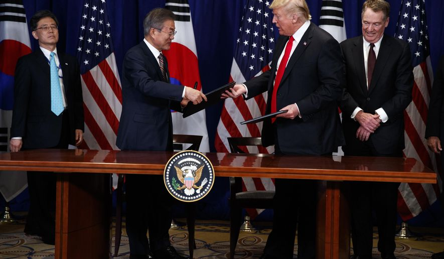 President Donald Trump and South Korean President Moon Jae-In participate in a signing ceremony for the United States-Korea Free Trade Agreement at the Lotte New York Palace hotel during the United Nations General Assembly, Monday, Sept. 24, 2018, in New York. (AP Photo/Evan Vucci)