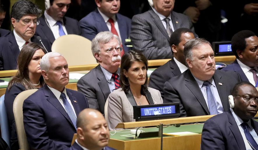 United States delegation Vice President Mike Pence, left center, National security adviser John Bolton, U.N. Ambassador Nikki Haley, second from right, and Secretary of State Mike Pompeo, far right, listens as President Donald address the United Nations General Assembly, Tuesday Sept. 25, 2018 at U.N. headquarters. (AP Photo/Bebeto Matthews)
