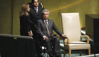 Ecuador's President Lenin Moreno Garces waits to address the 73rd session of the United Nations General Assembly, at U.N. headquarters, Tuesday, Sept. 25, 2018. (AP Photo/Richard Drew)