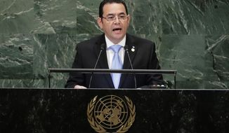 Guatemala's President Jimmy Morales addresses the 73rd session of the United Nations General Assembly Tuesday, Sept. 25, 2018, at the United Nations headquarters. (AP Photo/Frank Franklin II)