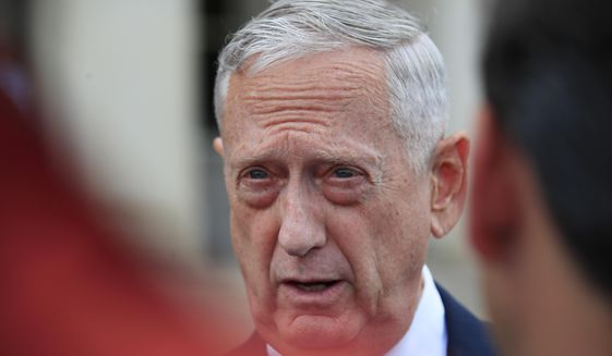In this Sept. 18, 2018, photo, Defense Secretary Jim Mattis speaks to reporters as he waits for the arrival of Philippine Secretary of National Defense Delfin Lorenzana at the Pentagon. (Associated Press) **FILE**