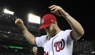 Washington Nationals Bryce Harper (34) gestures to their fans as the Nationals celebrate and bid goodbye to their fans ending their last home game of the season with a 9-3 rain delayed win against the Miami Marlins in Washington, Wednesday, Sept. 26, 2018. (AP Photo/Manuel Balce Ceneta)