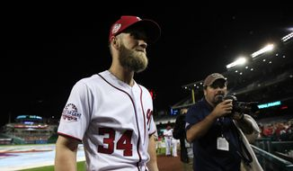 Washington Nationals Bryce Harper (34) leaves the field after the Nationals ended their last home game of the season with a 9-3 rain delayed win against the Miami Marlins in Washington, Wednesday, Sept. 26, 2018. (AP Photo/Manuel Balce Ceneta) ** FILE **