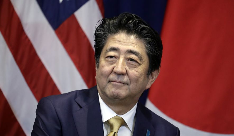 Japanese Prime Minister Shinzo Abe listens during a meeting with President Donald Trump at the Lotte New York Palace hotel during the United Nations General Assembly, Wednesday, Sept. 26, 2018, in New York. (AP Photo/Evan Vucci)