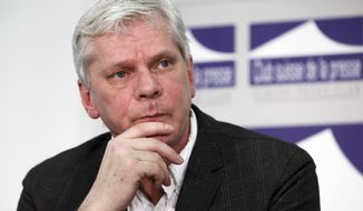 In this Monday, Jan. 26, 2015 file photo, Kristinn Hrafnsson, spokesman for the WikiLeaks organization, listens during a press conference, at the Press Club, in Geneva, Switzerland. WikiLeaks on Wednesday, Sept. 26, 2018 named one-time spokesman Kristinn Hrafnsson as its new editor-in-chief. The ramifications of the move are unclear. The organization was founded and has been led for more than a decade by Julian Assange, the 47-year-old ex-hacker, but the silver-haired Australian has been isolated for years at the Ecuadorean Embassy in London. (Salvatore Di Nolfi/Keystone via AP, file)
