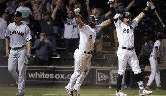 Chicago White Sox's Yolmer Sanchez, center, and Avisail Garcia, right, celebrate after Daniel Palka hit the game-winning two-run single, as Cleveland Indians relief pitcher Carlos Carrasco, left, heads to the dugout at the end of a baseball game Tuesday, Sept. 25, 2018, in Chicago. The White Sox won 5-4. (AP Photo/Nam Y. Huh)