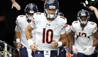 FILE - In this Sunday, Sept. 23, 2018, file photo, Chicago Bears quarterback Mitchell Trubisky (10) runs onto the field before an NFL football game against the Arizona Cardinals in Glendale, Ariz. It was apparent Trubisky took a step back in several ways in a win over the Cardinals, but he and the offense will need to pick up the pace with his own defense facing injury concerns at cornerback this week against Tampa Bay.(AP Photo/Rick Scuteri, File)