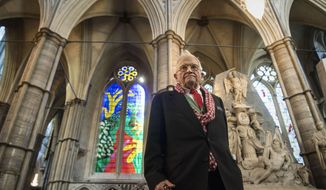 British artist David Hockney stands in front of The Queen's Window, a new stained glass window at Westminster Abbey, London, designed by David Hockney and revealed for the first time on Wednesday Sept. 26, 2018. (Victoria Jones/Pool via AP)