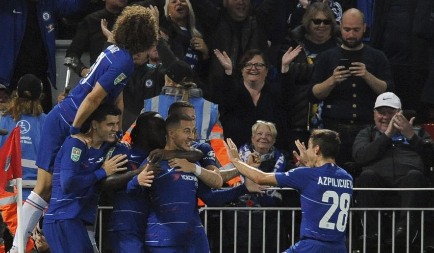 Chelsea's Eden Hazard, center, celebrates with teammates after scoring his side's second goal during the English League Cup soccer match between Liverpool and Chelsea at Anfield stadium in Liverpool, England, Wednesday, Sept. 26, 2018. (AP Photo/Rui Vieira)