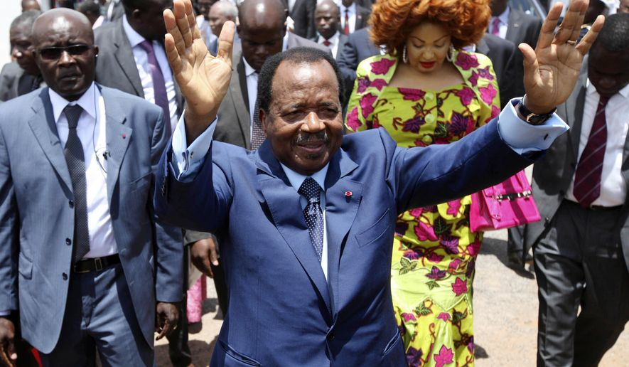 FILE - In this Sunday Oct 9, 2011 file photo, Cameroon President Paul Biya waves after casting his vote during the presidential elections in Yaounde, Cameroon. A bloody conflict between Cameroon's government and Anglophone separatists over language is now threatening next month's presidential election. The 85-year-old President Paul Biya, one of Africa's longest-serving leaders, vows to hold the largely Francophone country together even as thousands flee violence in English-speaking regions. (AP Photo/Sunday Alamba, File)