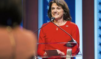 """FILE - In this July 26, 2018, file photo, Republican U.S. Senate candidate Leah Vukmir stands at her podium during a debate in Milwaukee. Vukmir, who has campaigned on the promise of """"draining the swamp,"""" is in Washington, D.C., for a series of fundraisers, including one on Wednesday, Sept. 26 with Senate Majority Leader Mitch McConnell of Kentucky and other top Republican senators. Vukmir faces Democratic Sen. Tammy Baldwin in the November election. (Tyger Williams /Milwaukee Journal-Sentinel via AP, File)"""