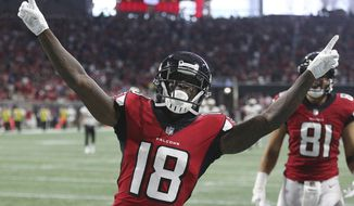 FILE - In this Sept. 23, 2018, file photo, Atlanta Falcons wide receiver Calvin Ridley reacts after catching his second touchdown pass from Matt Ryan during the second quarter of an NFL football game against the New Orleans Saints, in Atlanta. Ridley's first time touching the ball against the Saints last Sunday was as a tailback. He then made his mark at his real position of wide receiver, setting a team rookie record with three TD catches in his breakout game that could impact other teams' defensive plans, including Cincinnati this week. (Curtis Compton/Atlanta Journal-Constitution via AP, File)