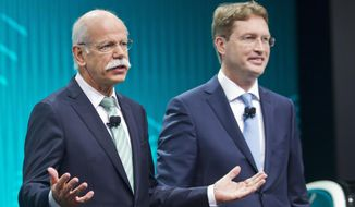 FILE - In this Jan. 13, 2014 file photo Mercedes-Benz marketing chief Ola Kallenius, right, stand with Daimler Chairman Dieter Zetsche at the end of a press conference at the North American International Auto Show in Detroit, Mich. Daimler AG said Wednesday, Sept. 26, 2018 that Kallenius will take over as the company's CEO in 2019. (AP Photo/Tony Ding, file)