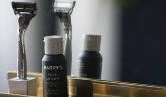 In this June 15, 2018, photo, the Winston razor and Harry's face lotion are on display at the headquarters of Harry's Inc., in New York. Armed with $112 million in new financing, the online startup that took on razor giants Gillette and Schick with its direct-to-consumer subscription model is investigating what other sleepy products might be ripe for disruption. (AP Photo/Mary Altaffer)