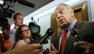 Sen. Chuck Grassley, R-Iowa, right, answers questions from reporters about allegations of sexual misconduct against Supreme Court nominee Brett Kavanaugh, Wednesday, Sept. 26, 2018, as he arrives for a Senate Finance Committee hearing on Capitol Hill in Washington. (AP Photo/Jacquelyn Martin) ** FILE **
