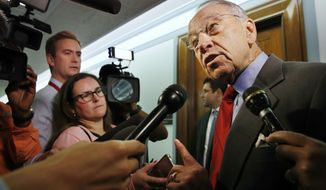 Sen. Chuck Grassley, R-Iowa, right, answers questions from reporters about allegations of sexual misconduct against Supreme Court nominee Brett Kavanaugh, Wednesday, Sept. 26, 2018, as he arrives for a Senate Finance Committee hearing on Capitol Hill in Washington. (AP Photo/Jacquelyn Martin)