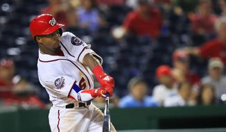 Washington Nationals Victor Robles (16) swings his bat and misses during the seventh inning of a baseball game against the Miami Marlins in Washington, Wednesday, Sept. 26, 2018. (AP Photo/Manuel Balce Ceneta) **FILE**