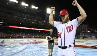Washington Nationals Bryce Harper (34) bows his head and raise his arms with clenched fists as the Nationals celebrate and bid goodbye to their fans ending their last home game of the season with a 9-3 rain delayed win against the Miami Marlins in Washington, Wednesday, Sept. 26, 2018. (AP Photo/Manuel Balce Ceneta) ** FILE **