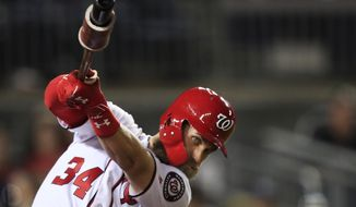 Washington Nationals Bryce Harper practices his swing during the seventh inning of a baseball game against the Miami Marlins in Washington, Wednesday, Sept. 26, 2018. (AP Photo/Manuel Balce Ceneta) ** FILE **