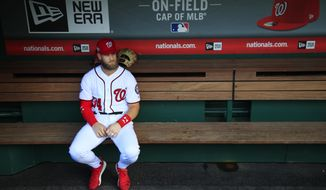 Washington Nationals Bryce Harper, looks at the baseball field from their dug out before the start of the Nationals last home game of the season against the Miami Marlins in Washington, Wednesday, Sept. 26, 2018. (AP Photo/Manuel Balce Ceneta) **FILE**