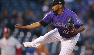 Colorado Rockies starting pitcher German Marquez works against the Philadelphia Phillies in the first inning of a baseball game Wednesday, Sept. 26, 2018, in Denver. (AP Photo/David Zalubowski)