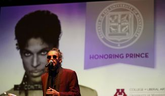 "Cameron Kinghorn sings ""1999"" during a ceremony awarding the late rock star Prince with an honorary degree at the Ted Mann Concert Hall Wednesday, Sept. 26, 2018, in Minneapolis. The University of Minnesota awarded Prince an honorary degree to recognize his influence on music and his role in shaping his hometown of Minneapolis. (Aaron Lavinsky/Star Tribune via AP)"