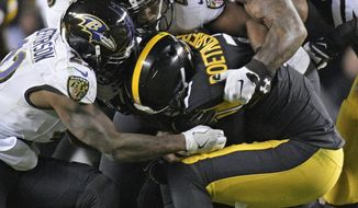 FILE - In this Dec. 10, 2017, file photo, Pittsburgh Steelers quarterback Ben Roethlisberger (7) is sacked by Baltimore Ravens outside linebacker Terrell Suggs (55), cornerback Anthony Levine (41), and strong safety Tony Jefferson (23) during the first half of an NFL football game in Pittsburgh. As the Ravens approach another prime time AFC North showdown against the Pittsburgh Steelers, their No. 1 priority is same as it's always been: stop Ben Roethlisberger. (AP Photo/Don Wright, File)
