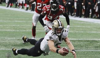 FILE - In this Sunday, Sept 23, 2018, file photo, New Orleans Saints quarterback Drew Brees dives into the end zone to score late in the fourth quarter of an NFL football game in Atlanta. Those looking for signs of decline in 39-year-old Saints quarterback Drew Brees might have to wait a while longer.  (Curtis Compton/Atlanta Journal-Constitution via AP, File)