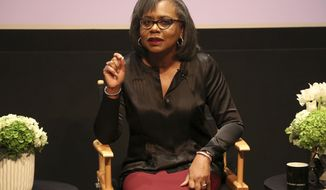 FILE - In this Dec. 8, 2017, file photo, Anita Hill speaks at a discussion about sexual harassment and how to create lasting change from the scandal roiling Hollywood at United Talent Agency in Beverly Hills, Calif. Hill says she 'can't imagine' the upcoming Supreme Court confirmation hearing on Thursday, Sept. 27, 2018, for Brett Kavanaugh will be fair to his accuser. But she says the much-anticipated hearing shouldn't be seen as a referendum on the #MeToo movement. (Photo by Willy Sanjuan/Invision/AP, File)