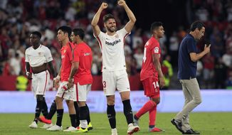Sevilla's Sergi Gomez waves at the end of the match during La Liga soccer match between Sevilla and Real Madrid at the Sanchez Pizjuan stadium, in Seville, Spain on Wednesday, Sept. 26, 2018. Sevilla won 3-0. (AP Photo/Miguel Morenatti)
