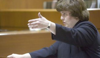 In this Oct. 27, 2004 photo Rachel Mitchell makes an opening statement in the trial of Karl LeClaire at court in Mesa, Ariz.  Senate Republicans are bringing Mitchell to handle questioning about allegations of sexual assault against Supreme Court nominee Brett Kavanaugh at Thursday, Sept. 27, 2018  Senate Judiciary Committee hearing. (Jack Kurtz/The Arizona Republic via AP)