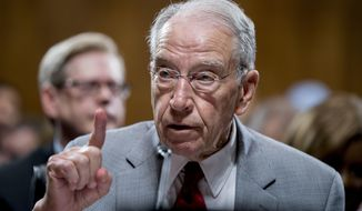 """FILE - In this Thursday, Sept. 13, 2018 file photo, Senate Judiciary Committee Chairman Chuck Grassley, R-Iowa, speaks during a Senate Judiciary Committee markup meeting on Capitol Hill, in Washington. Senate Republicans are bringing in Arizona prosecutor Rachel Mitchell to handle questioning about Christine Blasey Ford's allegations of sexual assault against Kavanaugh at the Senate Judiciary Committee hearing Thursday, Sept. 27, 2018. A news release from Grassley's office describes Mitchell as """"a career prosecutor with decades of experience prosecuting sex crimes."""" (AP Photo/Andrew Harnik, File)"""