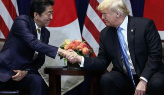 President Donald Trump meets with Japanese Prime Minister Shinzo Abe at the Lotte New York Palace hotel during the United Nations General Assembly, Wednesday, Sept. 26, 2018, in New York. (AP Photo/Evan Vucci)