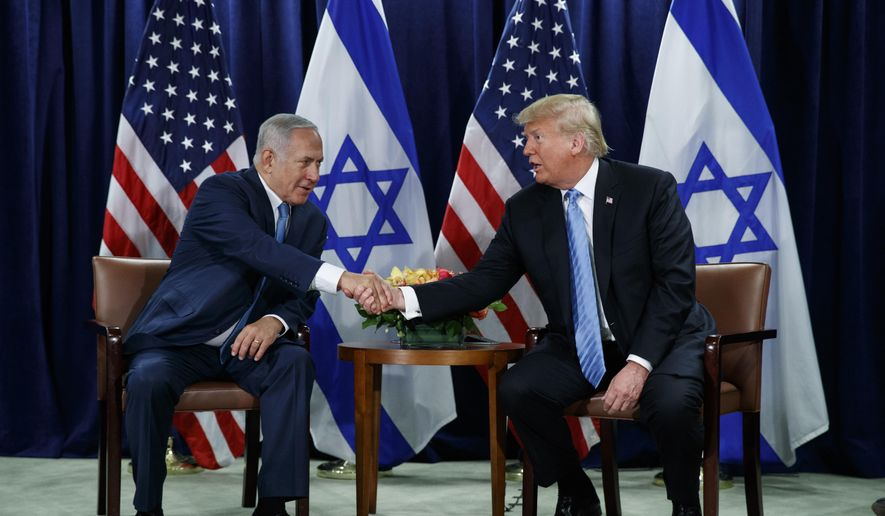 President Donald Trump shakes hands with Israeli Prime Minister Benjamin Netanyahu at the United Nations General Assembly, Wednesday, Sept. 26, 2018, at U.N. Headquarters. (AP Photo/Evan Vucci)